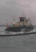 Approaching tug CANNIS